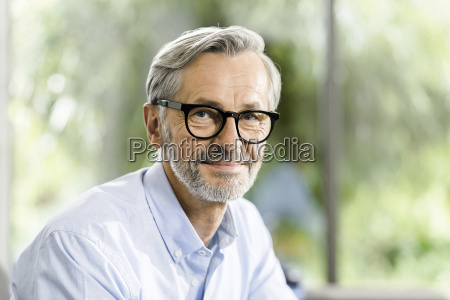 portrait of smiling man with grey