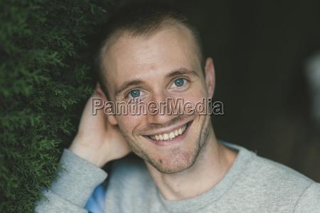 portrait of smiling blue eyed man