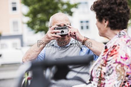senior man taking photo of his
