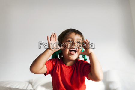 portrait of little boy pulling funny