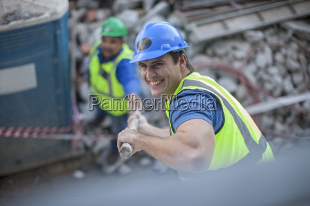 smiling construction worker on construction site