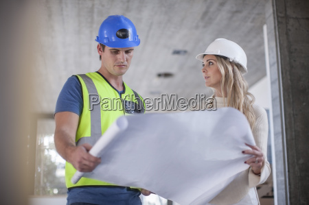 construction worker and woman looking on