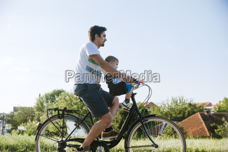 little boy on bicycle tour with