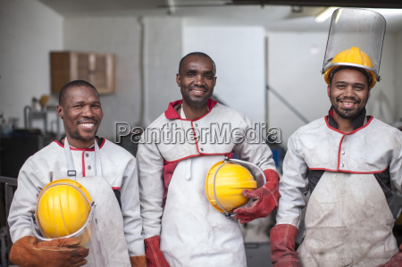portrait of three smiling workers with