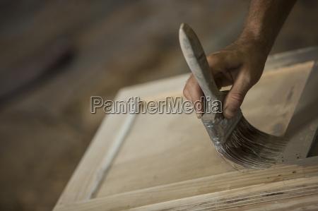 carpenter painting on wood