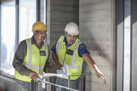 two construction workers discussing on construction