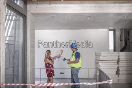 construction worker and woman with color