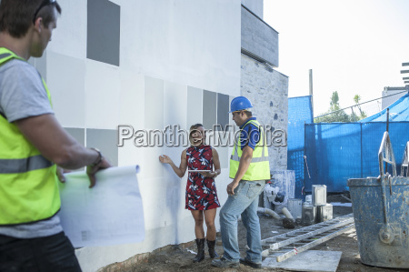 construction worker and woman talking on