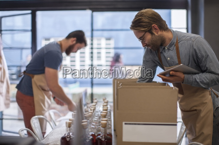 two colleagues shipping liquor in a