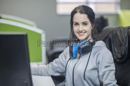 portrait of smiling young wearing headphones