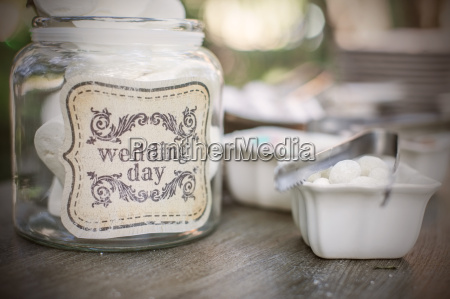 sweets in glass jar with wedding