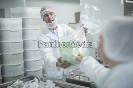 lab worker in pharmaceutical plant handing