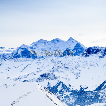 winter snow covered mountain peaks in