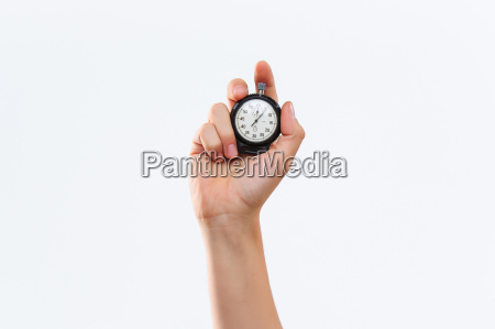 hand holding a stopwatch against a