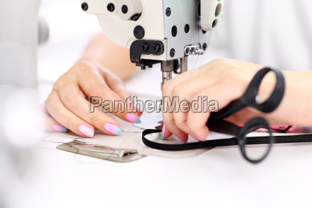sewing machine the woman sews on