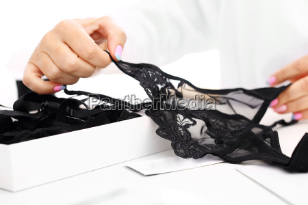 the woman is packing a gift