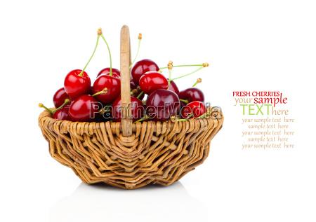basket full of fresh red cherries