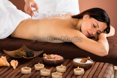 woman receiving cupping treatment on back