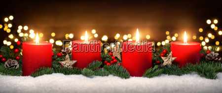 advent decoration with four candle flames