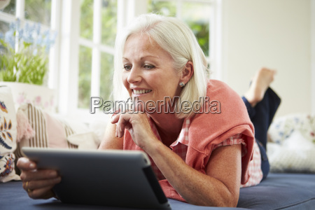 middle aged woman using digital tablet