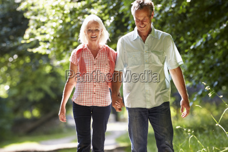 romantic middle aged couple walking along