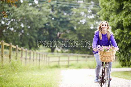 teenage girl riding bike along country