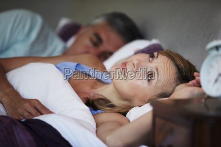 couple in bed with wife suffering