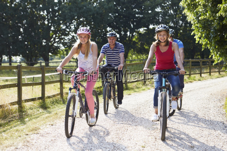 family with teenage children on cycle