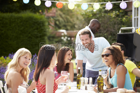 group of friends having outdoor barbeque