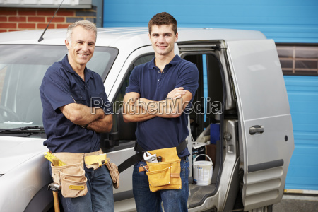 workers in family business standing next