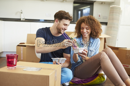 couple moving into new home enjoying