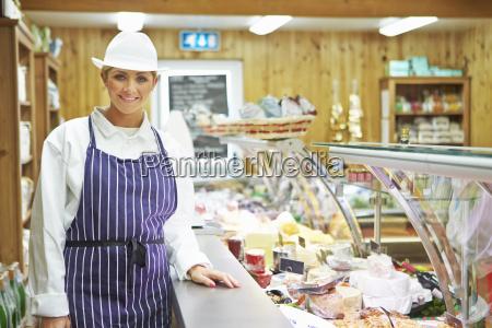 female sales assistant in delicatessen