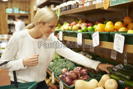 female customer at vegetable counter of