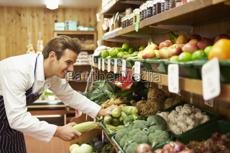male sales assistant at vegetable counter