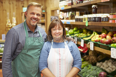 two sales assistant at vegetable counter