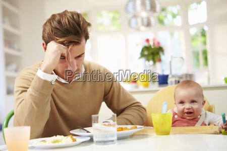 father feeling depressed at babys mealtime
