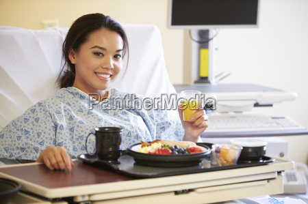 female patient enjoying meal in hospital