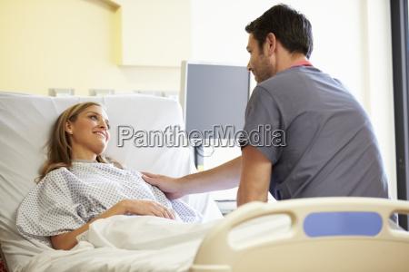 male nurse talking with female patient