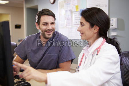female doctor with male nurse working