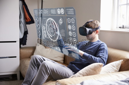 man sitting on sofa at home