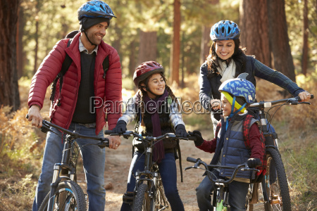 hispanic family on bikes in a