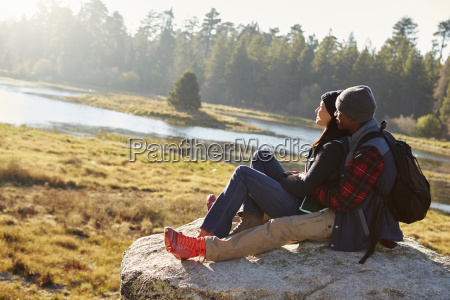 mixed race couple on a rock