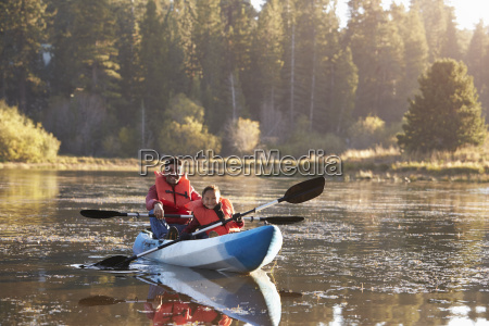 father and son kayaking on rural
