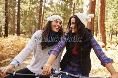 lesbian couple on bikes in a