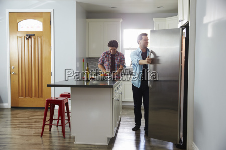 male couple in the kitchen preparing