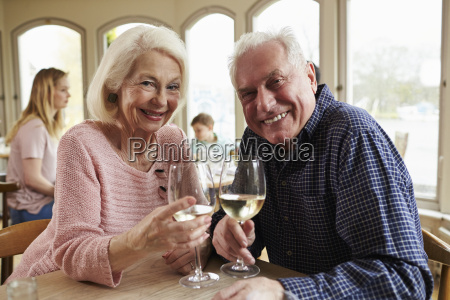 senior couple enjoying glass of wine