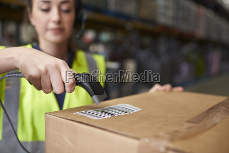 woman using barcode reader on a