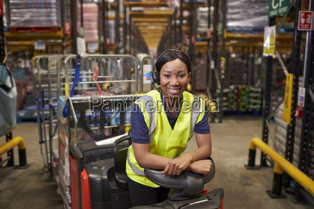 woman leaning on a tow tractor