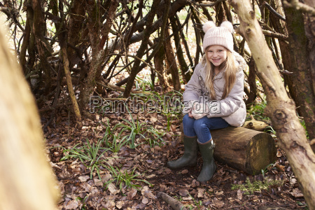 young girl sitting in a forest
