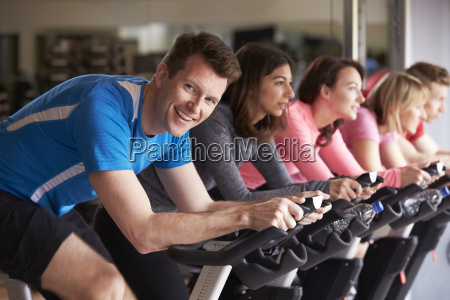 man in a spinning class at